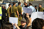 Israeli and foreign protesters argue with Israeli security forces as they protest against the arrival of thousands of Jewish visitors to the city, in the centre of the divided West Bank city of Hebron, 25 October 2013. Some of the protesters, foreigners and Israeli were arrested and taken for questioning after they refused to disperse. Photo by Mamoun Wazwaz
