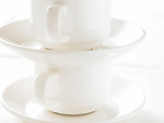Two stacked coffee cups and saucers