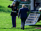 United States President Donald J. Trump salutes the Marine Guard as he boards Marine One after making remarks and answers questions from the media as he departs the South Lawn of the White House in Washington, DC for a day of activities in San Antonio, Texas and Houston, Texas on April 10, 2019.<br /> Credit: Ron Sachs / CNP