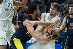 Real Madrid Luka Doncic and Fenerbahce Dogus Melih Mahmutoglu during Turkish Airlines Euroleague match between Real Madrid and Fenerbahce Dogus at Wizink Center in Madrid , Spain. March 02, 2018. (ALTERPHOTOS/Borja B.Hojas)