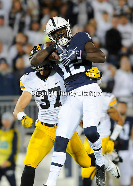 05 November 2016:  Penn State WR Chris Godwin (12) makes a one-handed catch downfield while Iowa S Brandon Snyder (37) covers him. The Penn State Nittany Lions vs. the Iowa Hawkeyes at Beaver Stadium in State College, PA. (Photo by Randy Litzinger/Icon Sportswire)
