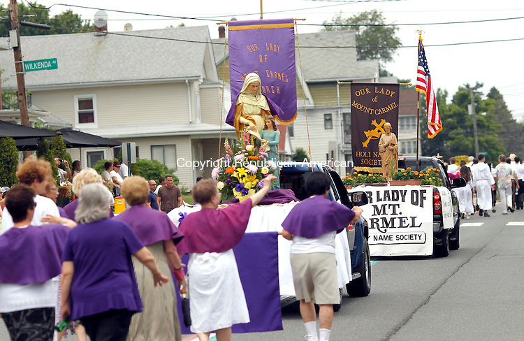 Waterbury, CT-15 July 2012-071512CM09- The Our Lady of Mount Carmel processional  makes its way down Highland Ave Sunday afternoon in the Waterbury.  The 4 day event, in its 74th year, featured a Mass in Honor of Our Lady of Mount Carmel, followed by the procession through the Town Plot neighborhood.   Christopher Massa Republican-American