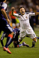 LA Galaxy midfielder Dema Kovalenko is taken down from behind. The LA Galaxy defeated the New England Revolution 1-0 at Home Depot Center stadium in Carson, California on Saturday evening March 27, 2010.  .