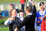 Miguel Angel Jiminez hugs Peter Hanson on the 18th green after winning their match in the Session 3 Foursomes and Fourball Matches during Day 3 of the The 2010 Ryder Cup at the Celtic Manor, Newport, Wales, 3rd October 2010..(Picture Eoin Clarke/www.golffile.ie)