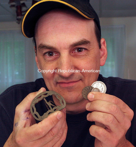 OXFORD, CT-07 June 2006-060706TK14- Jeremiah Burr, president of National Metal Detecting league has recently inducted into the Metal Detecting Hall of Fame. Burr displays from his collection a colonial shoe buckle and coins of a 1787 Fugio, a 1780 Reale Spanish Coin and a 1900 Barber half. Tom Kabelka Republican-American (Jeremiah Burr)