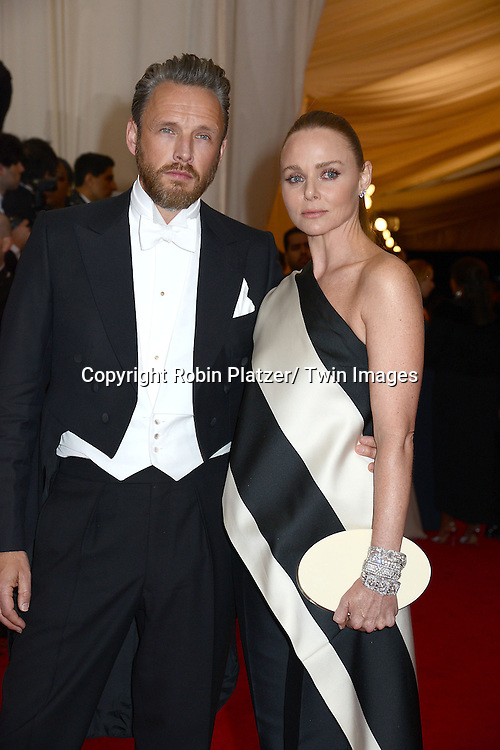 Stella McCartney and Alasdhair Willis attends the Costume Institute Benefit on May 5, 2014 at the Metropolitan Museum of Art in New York City, NY, USA. The gala celebrated the opening of Charles James: Beyond Fashion and the new Anna Wintour Costume Center.