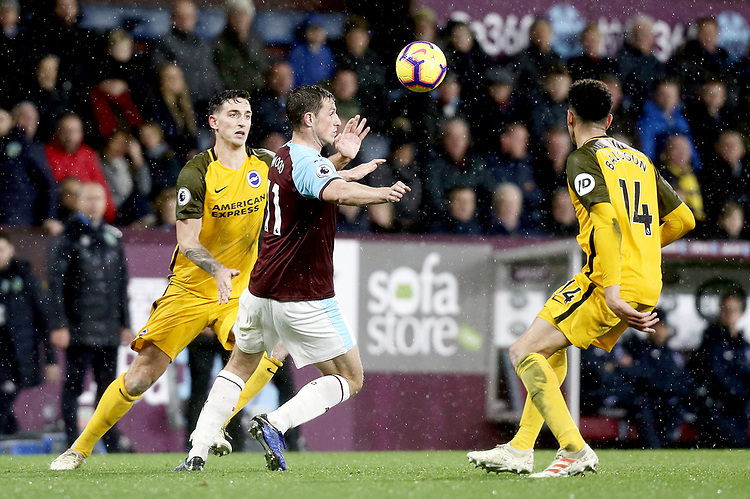 Burnley's Chris Wood under pressure from Brighton & Hove Albion's Lewis Dunk (left) and Leon Balogun<br /> <br /> Photographer Rich Linley/CameraSport<br /> <br /> The Premier League - Burnley v Brighton and Hove Albion - Saturday 8th December 2018 - Turf Moor - Burnley<br /> <br /> World Copyright © 2018 CameraSport. All rights reserved. 43 Linden Ave. Countesthorpe. Leicester. England. LE8 5PG - Tel: +44 (0) 116 277 4147 - admin@camerasport.com - www.camerasport.com