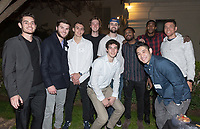 Most of the current men's basketball team and<br /> Gregory Karapoulios '17<br /> Jay Miller '17<br /> Andrew Johnson '17<br /> Now in his 30th year as Oxy's head men's basketball coach, Brian Newhall received a much deserved celebration with a surprise halftime ceremony and post game reception in the Booth Hall courtyard with more than 70 former and current players from all different generations and decades in attendance, on Saturday, Jan. 26, 2019.<br /> Newhall is the winningest coach in Oxy history and has a 100 percent graduation rate in his 30 years at the helm of the program. His resume boasts multiple SCIAC Championships and NCAA Playoff appearances, along with a run to the NCAA Division III Elite Eight in 2003 and the only perfect 14-0 season in SCIAC history. Newhall has not only coached at Oxy, but was a SCIAC Champion and SCIAC Player of the Year during his playing career at Oxy in the early 80s.<br /> (Photo by Marc Campos, Occidental College Photographer)