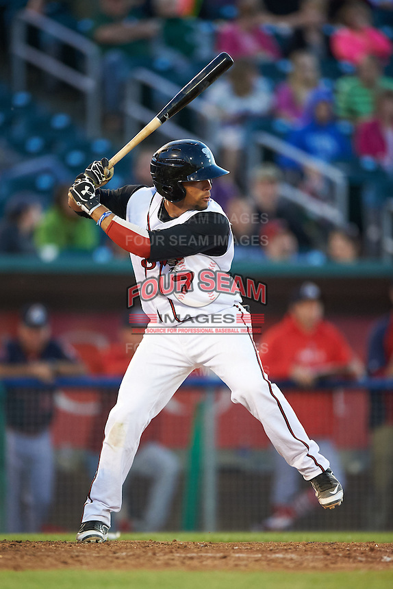 Lansing Lugnuts catcher Michael De La Cruz (7) at bat during a game against the Peoria Chiefs on June 6, 2015 at Cooley Law School Stadium in Lansing, Michigan.  Lansing defeated Peoria 6-2.  (Mike Janes/Four Seam Images)