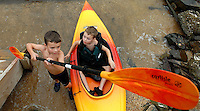 Two young boys try their hand at kayaking in the Chesapeake Bay in Anne Arundel County, Maryland.