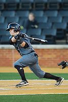 Ryan Quinn (30) of the Cincinnati Bearcats follows through on his swing against the Wake Forest Demon Deacons at Wake Forest Baseball Park on February 21, 2014 in Winston-Salem, North Carolina.  The Bearcats defeated the Demon Deacons 5-0.  (Brian Westerholt/Four Seam Images)