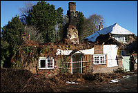 BNPS.co.uk (01202 558833)<br /> Pic :  CarolineLewis/BNPS<br /> <br /> The remains today.<br /> <br /> More than 50 firefighters battled to extinguish a huge blaze at the idyllic thatched holiday cottage in Affpuddle.<br /> <br /> Peony Cottage, in the picturesque village of Affpuddle in Dorset, caught fire at around 7.20pm last night (Thurs).<br /> <br /> The five-bed property had been accommodating two families, thought to be on holiday from America, although no one was hurt in the fire.