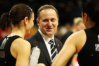 NZ prime minister John Key chats with Maree Bowden and Joline Henry after the match during the International  Netball Series match between the NZ Silver Ferns and World 7 at TSB Bank Arena, Wellington, New Zealand on Monday, 24 August 2009. Photo: Dave Lintott / lintottphoto.co.nz