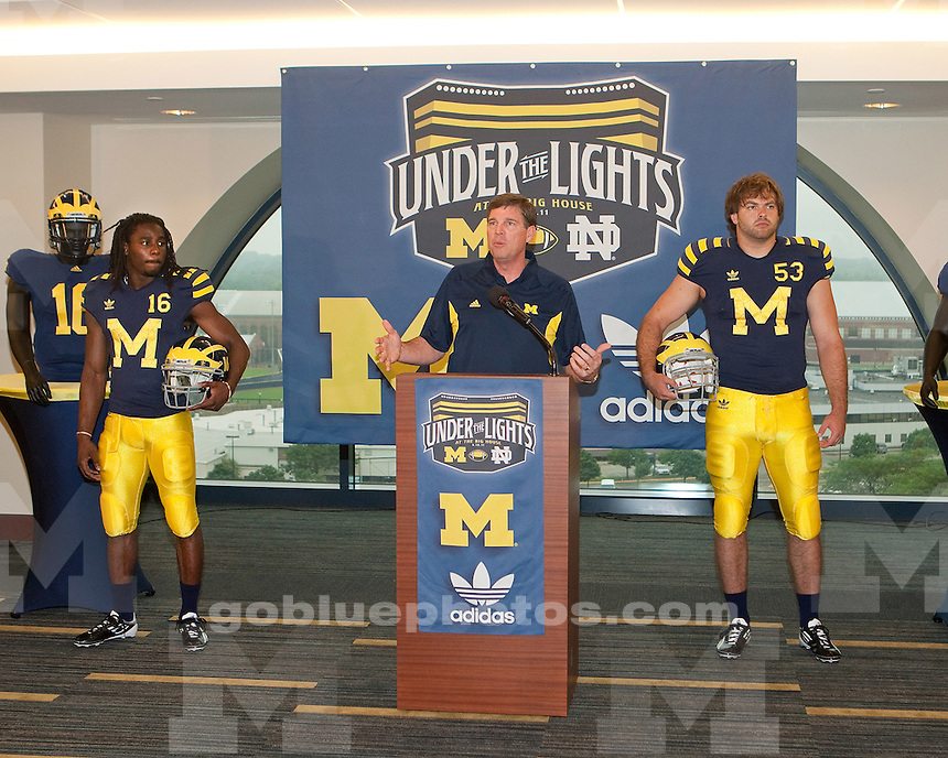 "Unveiling of the legacy jersey at Michigan Stadium on June 10, 2011, for the ""Under the Lights"" football game against Notre Dame."