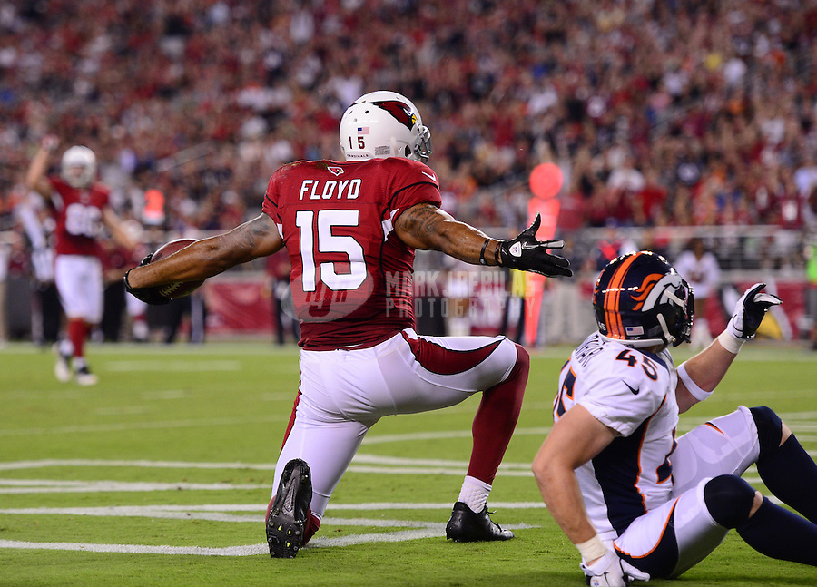 Aug. 30, 2012; Glendale, AZ, USA; Arizona Cardinals wide receiver (15) Michael Floyd celebrates after scoring a touchdown in the second quarter against the Denver Broncos during a preseason game at University of Phoenix Stadium. Mandatory Credit: Mark J. Rebilas-