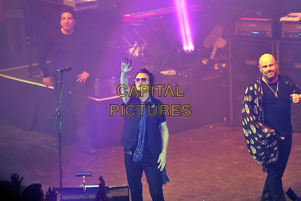 BLACK COUNTRY COMMUNION -  Derek Sherinian, Glenn Hughes, Jason Bonham.Black Country Communion perform on stage at Shepherds Bush Empire in London, England, UK, .December 30th, 2010..music concert gig performing live half full length band group black t-shirt sunglasses white shirt hand waving arm raised up .blue scarf .CAP/MAR.© Martin Harris/Capital Pictures.