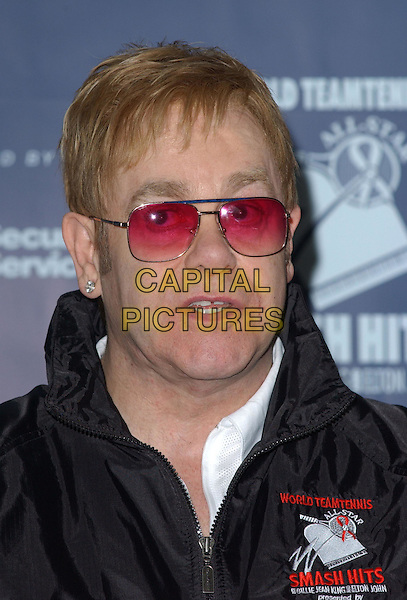 ELTON JOHN.Attends the 12th Annual World Team Tennis Smash Hits Press Conference benefiting The Elton John AIDS Foundation held at The Bren Events Center at UC Irvine in Irvine, California on October 11th 2004..portrait headshot pink sunglasses.Ref: DVS.www.capitalpictures.com.sales@capitalpictures.com.©Debbie VanStory/Capital Pictures .