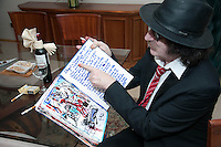 "Venezuela: Caracas,13/06/13 <br /> Argentine rock star Charly Garcia, poses in his room at the Hotel Eurobuilding in Caracas, while showing a notebook with sketches and ideas for the suite ""Parallel Lines"" which will premiere on September 23 at the Teatro Colon, Buenos Aires , Argentina. Garcia was in Caracas, accompanied by his band The Prostitution, giving a couple of concerts of his tour The Unknown Dimension.<br /> Carlos Hernandez/Archivolatino"