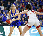 SIOUX FALLS, SD - MARCH 10: Sydney Stapleton #35 of the South Dakota State Jackrabbits looks for a teammate past the defense of Ciara Duffy #24 of the South Dakota Coyotes during the women's championship game at the 2020 Summit League Basketball Tournament in Sioux Falls, SD. (Photo by Richard Carlson/Inertia)