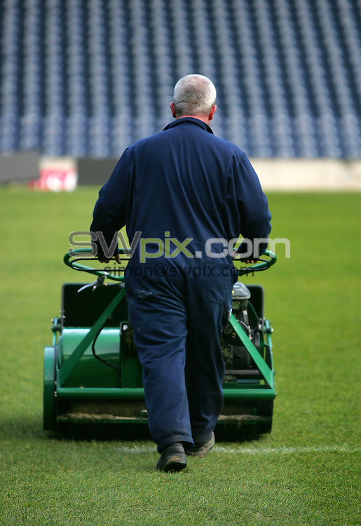 Supporters Club - Groundsman Cutting Grass.
