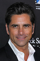 HOLLYWOOD, LOS ANGELES, CA, USA - MARCH 20: John Stamos at the 2nd Annual Rebels With A Cause Gala Honoring Larry Ellison held at Paramount Studios on March 20, 2014 in Hollywood, Los Angeles, California, United States. (Photo by Xavier Collin/Celebrity Monitor)