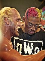 "NBA star Dennis Rodmon with Hulk Hogan during a NWO ""Bash at the Beach"" pro wrestling event in Daytona Beach, FL, July 1997.  (Photo by Brian Cleary/www.bcpix.com)"