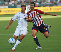 Chivas USA forward Ante Rozov (9) goes shoulder to shoulder with Real Salt Lake defender Ritchie Kotschau (6). CD Chivas USA beat Real Salt Lake 1-0 in a MLS game at the Home Depot Center in Carson, California, Sunday, August 26, 2007.