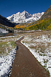 Hiking trail and autumn snow, Maroon Bells Peak, Aspen, Colorado John offers autumn photo tours throughout Colorado.