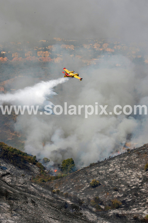 **ALL ROUND PICTURES FROM SOLARPIX.COM**                                 **WORLDWIDE SYNDICATION RIGHTS**                   Entrerrios fires near Fuengirola, Malaga, Spain...Fierce forrest fires threatened hundreds of ex pat homes close to the tourist resort of Fuengirola, in Malaga, Spain. last night and through today..Local reports suggest that the fires were started intentionally last night at 20.30, but fire fighters, armed with helicopters, water planes and fire engines battled through the night to save villas owned by Brits, Spanish and German residents and holiday makers, along with a vast amount of wild animals including cattle and deer. The fires gathered speed through the night, fanned by changing winds and spread as far down the coast as the hills above Elviria, another large ex pat community.                                                                          This pic:   Entrerrios fires near Fuengirola, Spain.                                                                                        JOB REF:    13930    AB1       DATE:  12.09.11                                                           **MUST CREDIT SOLARPIX.COM OR DOUBLE FEE WILL BE CHARGED**                                                                        **MUST NOTIFY SOLARPIX OF ONLINE USAGE**                 **CALL US ON: +34 952 811 768 or LOW RATE FROM UK 0844 617 7637**