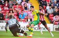 Lincoln City's Matt Green is denied by Norwich City's Time Klosse and goalkeeper Michael McGovern<br /> <br /> Photographer Andrew Vaughan/CameraSport<br /> <br /> Football Pre-Season Friendly - Lincoln City v Norwich City - Tuesday 10th July 2018 - Sincil Bank - Lincoln<br /> <br /> World Copyright &copy; 2018 CameraSport. All rights reserved. 43 Linden Ave. Countesthorpe. Leicester. England. LE8 5PG - Tel: +44 (0) 116 277 4147 - admin@camerasport.com - www.camerasport.com