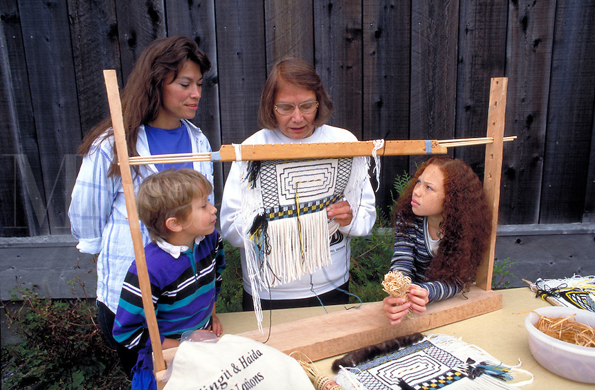 Native American weaver demonstrates Raven's Tail Design for her family members.