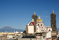Cathedral in Puebla, Mexico, with Popcatepetal Volcano in background. The historical center of Puebla is a UNESCO World Heritage Site.