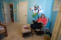 NWA Democrat-Gazette/J.T. WAMPLER Kim Umber with her dog Tito in her favorite room Monday August 28, 2017.