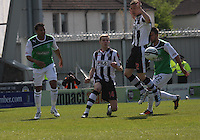 Marc McAusland (2nd left) clears from Thomas Soares, Jereon Tesselaar and George Francomb in the St Mirren v Hibernian Clydesdale Bank Scottish Premier League match played at St Mirren Park, Paisley on 29.4.12. ..