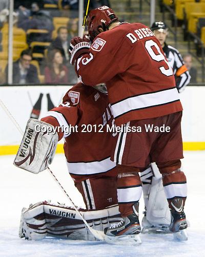 Steve Michalek (Harvard - 34), Danny Biega (Harvard - 9) - The Harvard University Crimson defeated the Northeastern University Huskies 3-2 in the 2012 Beanpot consolation game on Monday, February 13, 2012, at TD Garden in Boston, Massachusetts.