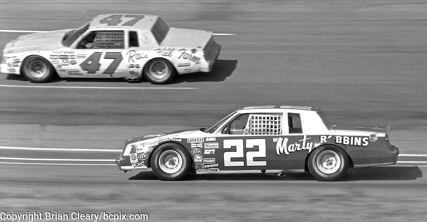 Marty Robbins drives on the apron as he is passed by Ron Bouchard during the Atlanta Journal 500, Atlanta International Raceway, Hampton, GA, November 7, 1982.  (Photo by Brian Cleary/www.bcpix.com)