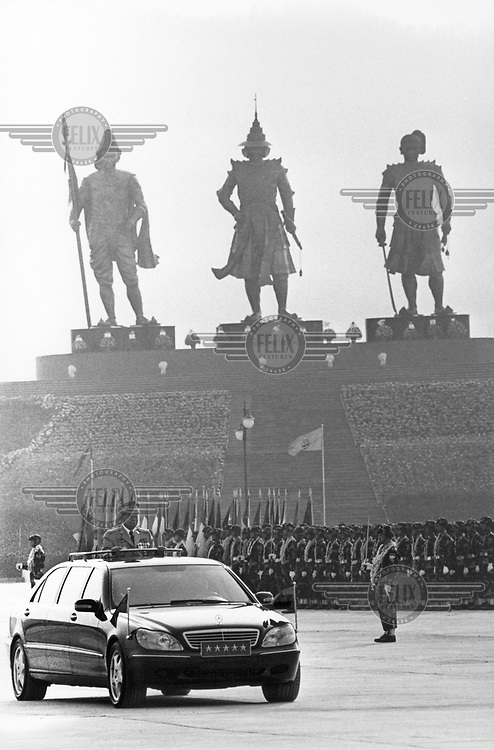 Senior General Than Shwe, the Burmese junta's supreme commander, inspects the troops on Armed Forces Day. 15,000 soldiers paraded in an annual event that is recognised as the day the modern Burmese army was founded. Behind them are statues of dead Burmese warrior kings (Anawrahta, Bayintnaung and Alaungpaya).