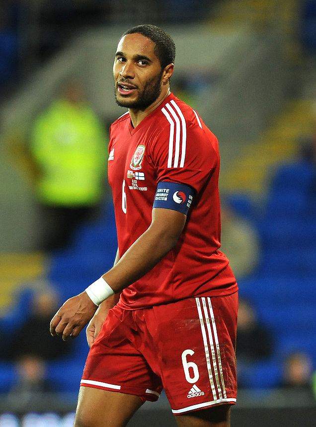 Wales Ashley Williams in action during todays match  <br /> <br /> Photo by Ashley Crowden/CameraSport<br /> <br /> Football - International Friendly - Wales v Finland - Saturday 16th November 2013 - Cardiff City Stadium - Cardiff<br /> <br /> &copy; CameraSport - 43 Linden Ave. Countesthorpe. Leicester. England. LE8 5PG - Tel: +44 (0) 116 277 4147 - admin@camerasport.com - www.camerasport.com