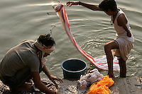 29.11.2008 Varanasi(Uttar Pradesh)<br /> <br /> Man and a young boy handicaped washing clothes in Ganga river.<br /> <br /> Homme et un jeune garcon handicapé en train de laver leur linge dans le Gange.