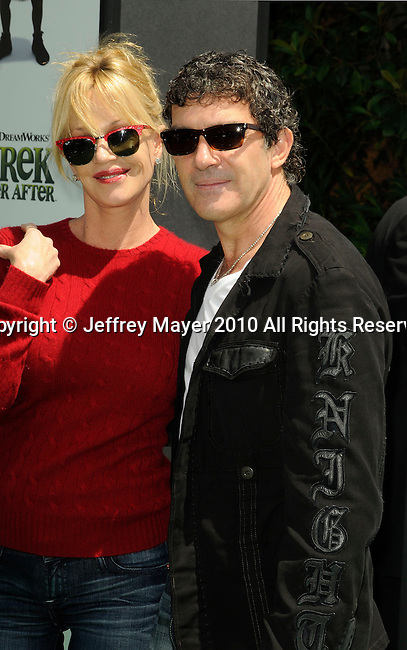 """UNIVERSAL CITY, CA. - May 16: Melanie Griffith and Antonio Banderas arrive at the """"Shrek Forever After"""" Los Angeles Premiere at Gibson Amphitheatre on May 16, 2010 in Universal City, California."""