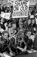 """Punks with """"shame on our representatives"""" sign at Gulf War protest<br />"""