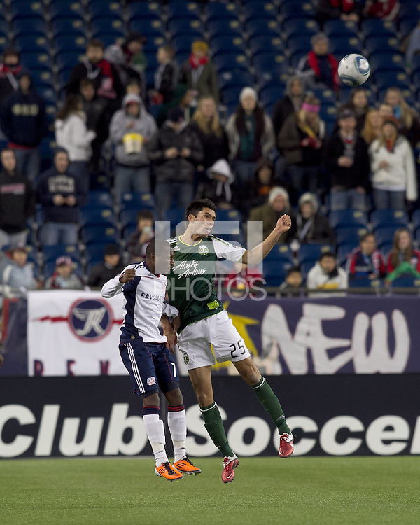 New England Revolution forward Sainey Nyassi (17) and Portland Timbers defender Steve Purdy (25) battle for head ball. In a Major League Soccer (MLS) match, the New England Revolution tied the Portland Timbers, 1-1, at Gillette Stadium on April 2, 2011.