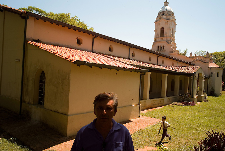 Father and son walk through the main church square at San Ignacio Guazu, Paraguay, the site of the oldest of scores of Jesuit missions in the area where Paraguay, Argentina and Brazil meet. (EDS NOTE: This is not the mission church, but a 20th-century replacement.) The missions were built in the 17th century and abandoned when the Jesuits were expelled in the 18th century. Ruins of some of these missions still haunt hilltops in the region. (Kevin Moloney for the New York Times)