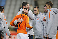 19th November 2019, Stadion De Vijverberg, Doetinchem, Netherlands; U-21 International football freindly, Netherlands versus England;  Netherlands player Javairo Dilrosun congratulated by Netherlands U21 coach Erwin van de Looi