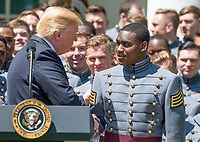 United States President Donald J. Trump recognizes quarterback and co-Captain Ahmad Bradshaw (17) as he presents the Commander-in-Chief's Trophy to the U.S. Military Academy football team in the Rose Garden of the White House in Washington, DC on Tuesday, May 1, 2018.  The Commander-in-Chief's trophy is presented to the winner of the annual Army-Navy football game which was played at Lincoln Financial Field in Philadelphia, Pennsylvania on December 9, 2017.  The Army Black Knights beat the Navy Midshipmen 14 - 13.<br /> Credit: Ron Sachs / CNP /MediaPunch