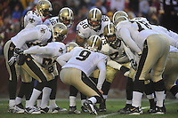 06 December 2009:  Saints QB Drew Brees (9) calls a play in the offensive huddle.  The New Orleans Saints defeated the Washington Redskins  33-30 in Overtime to improve to 12-0 on the season at FedEx Field in Landover, MD.