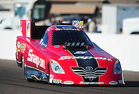 Feb. 18, 2012; Chandler, AZ, USA; NHRA funny car driver Cruz Pedregon during qualifying for the Arizona Nationals at Firebird International Raceway. Mandatory Credit: Mark J. Rebilas-