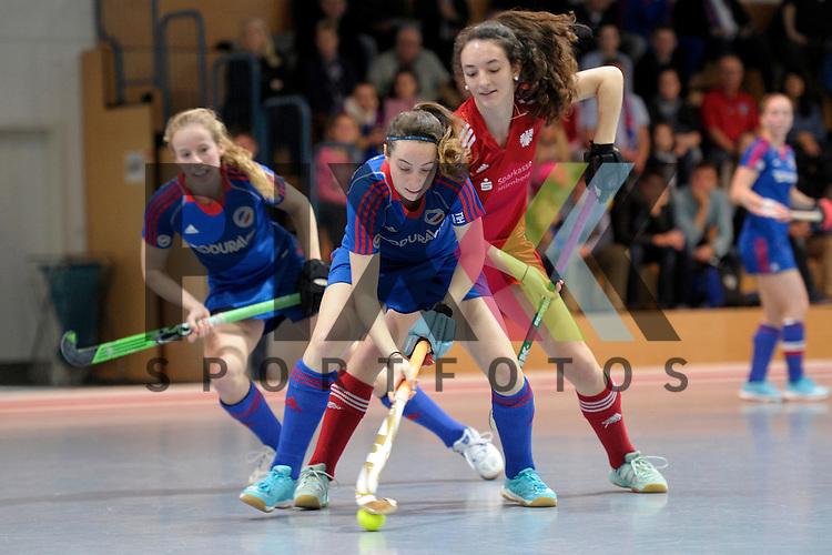 GER - Mannheim, Germany, December 19: During the 1. Bundesliga Sued Damen indoor hockey match between Mannheimer HC (blue) and Nuernberger HTC (red) on December 19, 2015 at Irma-Roechling-Halle in Mannheim, Germany.  Maxi Pohl #6 of Mannheimer HC, Salvina Strobel #8 of Nuernberger HTC<br /> <br /> Foto &copy; PIX-Sportfotos *** Foto ist honorarpflichtig! *** Auf Anfrage in hoeherer Qualitaet/Aufloesung. Belegexemplar erbeten. Veroeffentlichung ausschliesslich fuer journalistisch-publizistische Zwecke. For editorial use only.