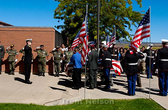 Marine Quinn Keith, killed in Iraq, was honored with a funeral procession through his hometown of Blanding, Utah, Wednesday. american flag<br />