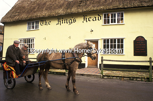The Kings Head, Low House. The village pub regulars arrive by Pony and Trap East Anglia UK
